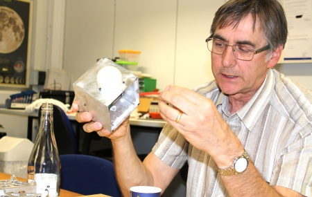 Dr William E Crofts holding CubeSat